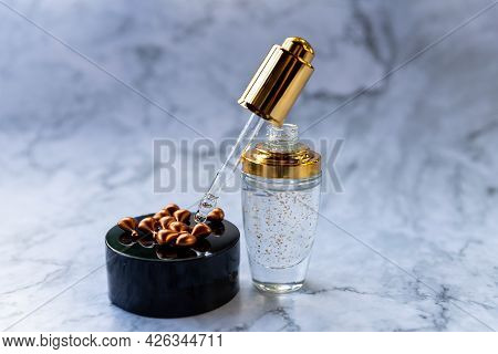 Eco Mineral Oil With Pipette Dropper. Transparent Hyaluronic Serum Gel And Skin Care Concept. Cosmet