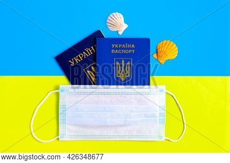On The Flag Of Ukraine, Passports Under A Protective Face Mask. Quarantine. Precautions During A Pan