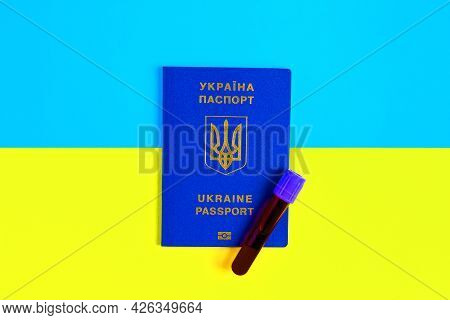 Virus Test. A Test Tube With Blood On A Passport Against The Background Of The Flag Of Ukraine. Mand