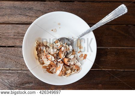 Overhead View Of Crushed Egg Shell In Bowl With Spoon. Egg Shells Are Organic Fertilizers For Garden
