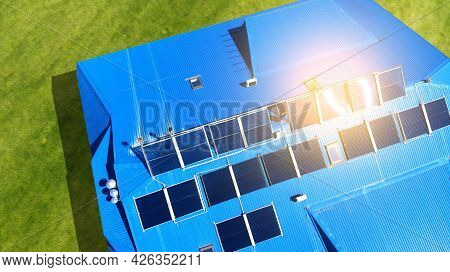 Aerial. Solar Panels On The Roof Of The House With Blue Tiles. View Above From Drone.