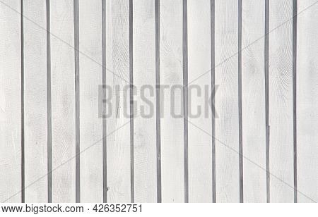 A Wooden Boards Background Painted In White