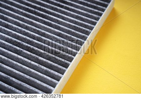 Car Cabin Carbon Air Filter On A Yellow Background.