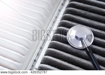 Car Air Filter - It Is A Lungs Of The Automobile. Concept With A New And Old Air Filters With Stetho