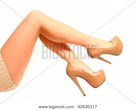 Female Legs With High Heels On A White Background