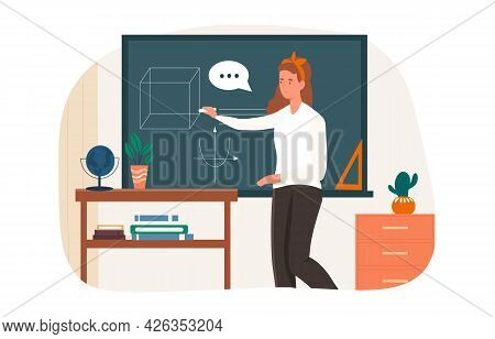 Young Female Teacher Is Drawing On Blackboard For A Class. Female School Teacher With Books And Chal