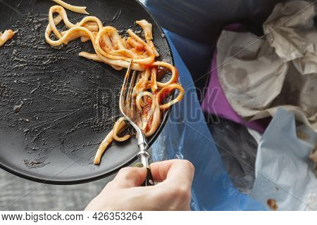 Leftover Wasted Spaghetti Pasta Thrown Bin. High Quality Beautiful Photo Concept