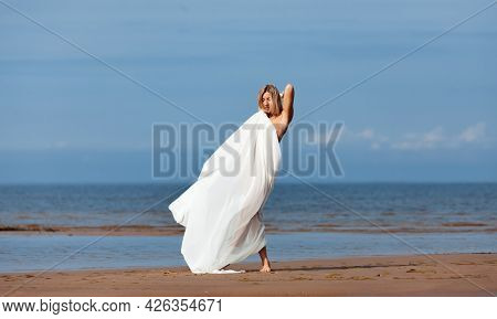 Nude Woman Posing With A White Fabric