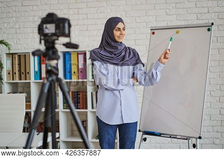 Young Arabian Woman Making A Video With A Business Lecture
