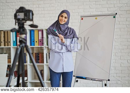 Muslim Business Woman Making A Video With A Lecture