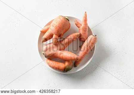 Abnormal Ugly Organic Carrots On White Background With Copy Space. Natural Vegetables.