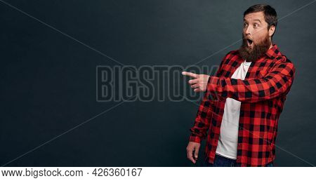 Astonished And Speechless Surprised Handsome Hipster Guy In Red Checkered Shirt, Drop Jaw And Gaspin