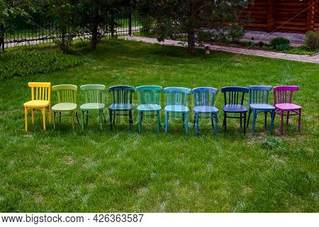 A Top View Of A Row Of Colorful Viennese Chairs In A Row , A Hobby For Painting Old Furniture And An