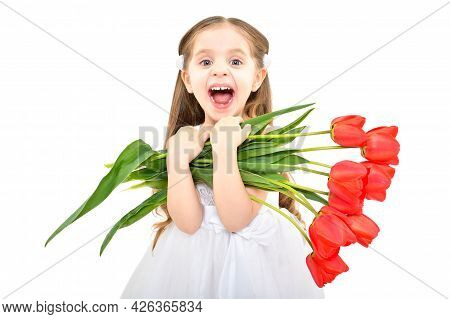 Portrait Of A Lovely Happy Girl Holding A Bouquet Of Tulips In Her Hands Isolated On White Backgroun