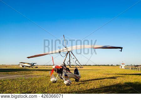 Motor Hang Glider Standing On Green Grass At Aerodrome, Bright Summer Day