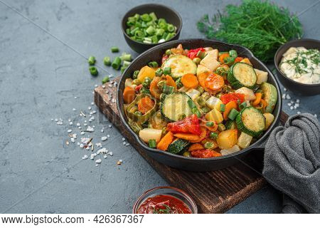 Frying Pan With Vegetable Stew On A Gray-blue Background. Side View, Space For Copying.