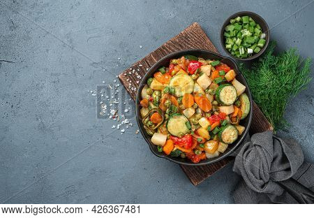 Vegetable Stew In A Frying Pan On A Gray Background With Space For Copying. Top View, Horizontal. Ve