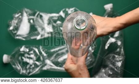 Pov Hands Crumple And Crush Plastic Pop Bottle For Recycling. Crumpled Plastic Bottles Ready For Rec