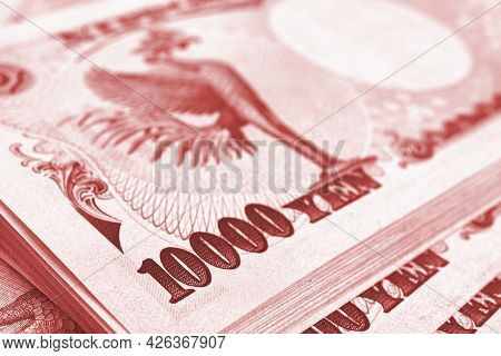 Bundle Of 10,000 Yen Japanese Bills. Light Red Tinted Backdrop Or Background About Money, Bookkeepin