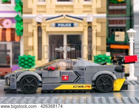 Tambov, Russian Federation - July 02, 2021 Lego Chevrolet Corvette C8.R car by LEGO Speed Champions on a city street