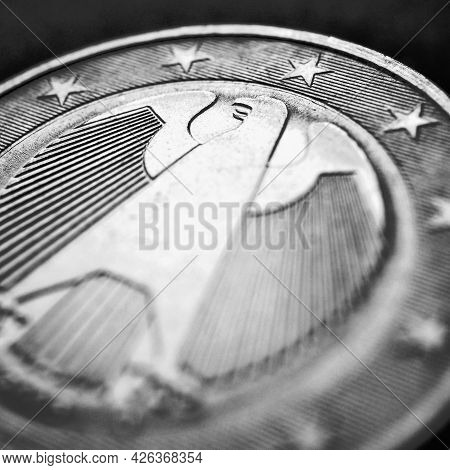 1 Euro Coin Issued In Germany Close-up. Obverse With The Federal Eagle. Dark Black And White Square
