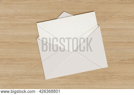 Blank Card Popping Out Of An Envelope. 3d Illustration.