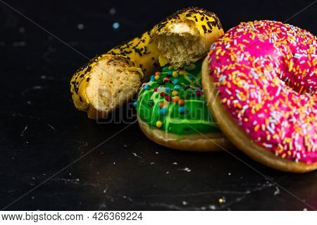 Bitten Yellow Glazed Donut With Sprinkles Isolated. Close Up Of Colorful Donuts.