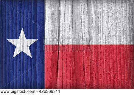 The Flag Of The State Of Texas On A Dry Wooden Surface. Bright Wallpaper Or Illustration Made Of Old