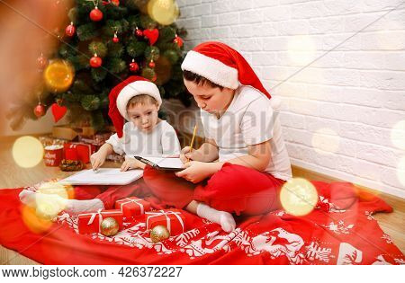 Happy Children Thinking About His Presents For Them. Merry Christmas Background, Xmas Celebrate, Hap