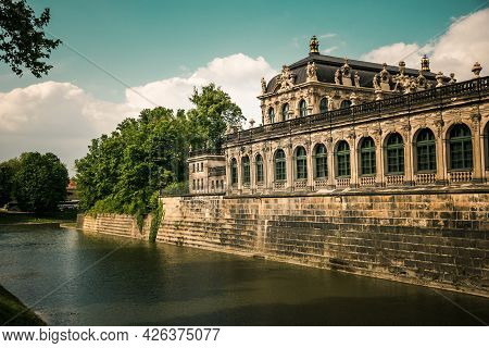 17 May 2019 Dresden, Germany - Zwingergraben (pond Og Zwinger) And Wall Of Palace.