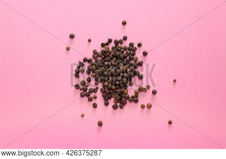 Dried Black Pepper Sprinkled On A Pink Background. A Healthy . Copy Space, Hard Shadows, Pop Art
