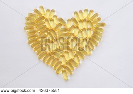 Omega 3 Capsules Laid Out In The Shape Of A Heart