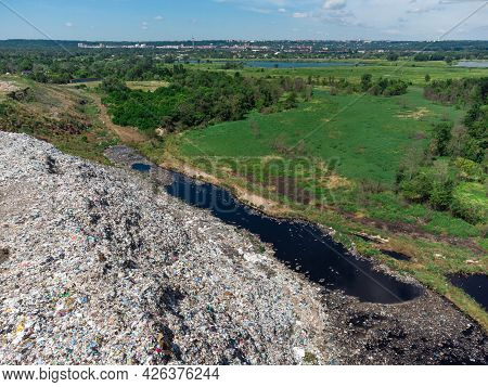 Aerial View Of Huge Rubbish Dump. Trash And Garbage Landfill. Ecology Problem, Nature Pollution. Con