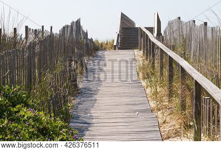 Walkway Over The Dunes Of Fire Island To Get To The Beach With Wooden Fences And Wood Walkway Over T