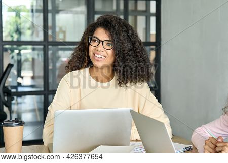 Young Happy Smiling African American Girl Student In Eyeglasses At Desk Working Using Pc Laptop Comp