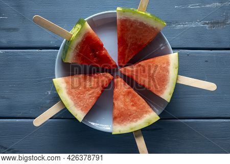 Sliced Watermelon. Slices On Rustic Blue Table. Copy Space.