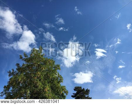 Pure White Spring Clouds In The Clear Sky Above The Swiss City Of St. Gallen, Switzerland (schweiz)