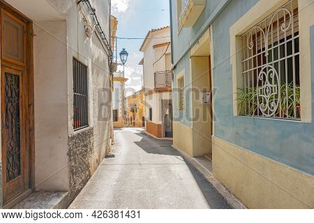 Narrow Picturesque Typically European Street Lined By Pastel Color Buildings