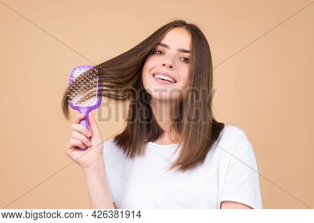 Woman Brushing Straight Natural Hair With Comb. Girl Combing Healthy Hair With Hairbrush. Hair Care