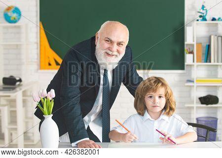 Professor Or Teacher Teaching Little Student Boy. Teacher Is Skilled Leader. Educational Conversatio