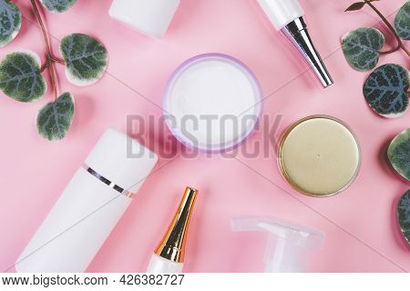 Mockup Cosmetic Bottle With Cream Or Lotion And Leaf Isolated On Pink Background, Mock Up Package Fo