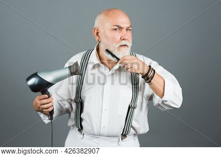 Vintage Barbershop, Shaving. Mature Hairdresser Barber With Hair Dryer And Comb Drying Beard And Mou