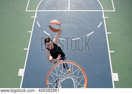 Angle View Of Man Playing Basketball, Above Hoop Of Man Shooting Basketball.