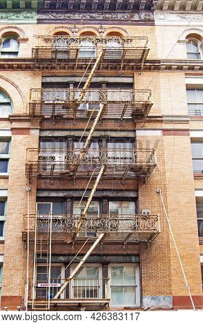 A Building In Nyc Downtown, Famous Fire Escape Stairs.