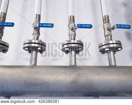 Metal Chrome Pipe With Flange And Set Of Valves.  Industrial Concept  Of Pipes And Valves Plumbing,