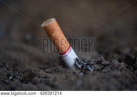 Cigarette Burning From Smoker Addictive Nicotine