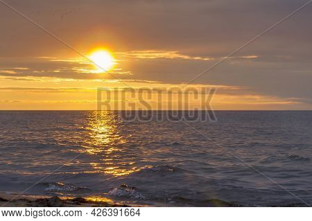 The Sun Sets Over The Horizon In The Baltic Sea