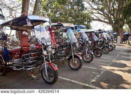 Chiang Saen, Chiang Rai Province, Thailand - February 19, 2019: Traditional Thai Auto Rickshaws (tuk