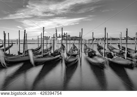 Blurred Gondolas At San Marco With View In Early Morning Light To Island San Georgio Maggiore In Ven