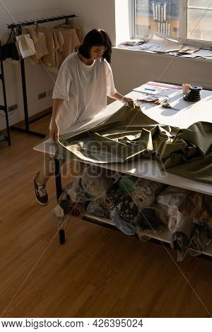 Woman Dressmaker Sew New Collection, Look On Fashionable Fabric On Work Table. Young Clothes Designe